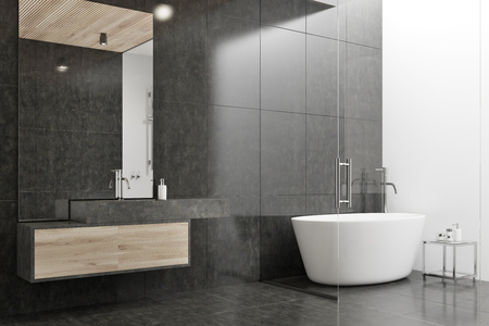 Black and white bathroom corner with a tiled floor, a white tub, and a sink with a large mirror. 3d rendering mock up