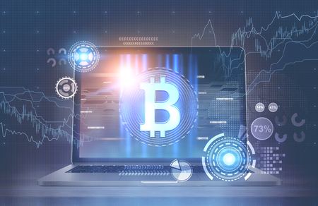 Laptop with a bitcoin emblem, HUD and graphs is standing on a white office desk. A blurred blue background. 3d rendering mock up toned image double exposure