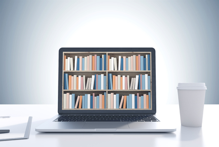 Laptop with bookshelves on its screen is standing on a white desk. A coffee cup. A gray wall background. 3d rendering mock up