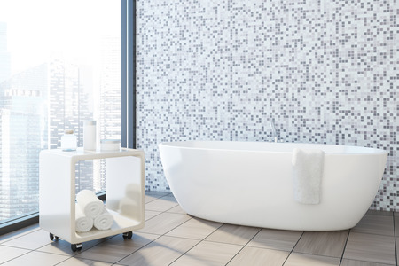 Gray tile and white bathroom corner with a white tub and a trolley with rolled towels. 3d rendering mock up Banco de Imagens