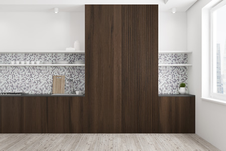 Tiled and wooden kitchen interior with a wooden floor, dark wooden countertops, and a cupboard. A window in the corner. 3d rendering mock up Stock Photo