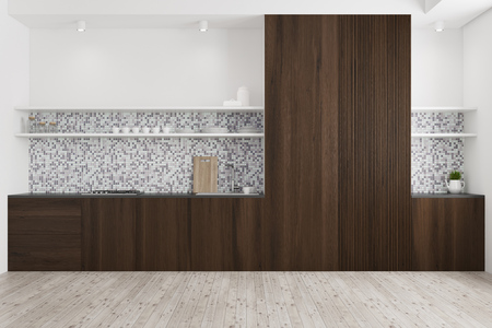 Tiled and wooden kitchen interior with a wooden floor, dark wooden countertops, and a cupboard. 3d rendering mock up Stock Photo