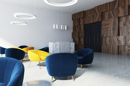 Office waiting room corner with white walls, and dark blue and yellow armchairs near round coffee tables. A panoramic window and a black door. 3d rendering mock up Stock Photo