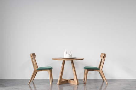 Round table with green and wooden chairs near it standing in an empty room with white walls and a concrete floor. 3d rendering mock up