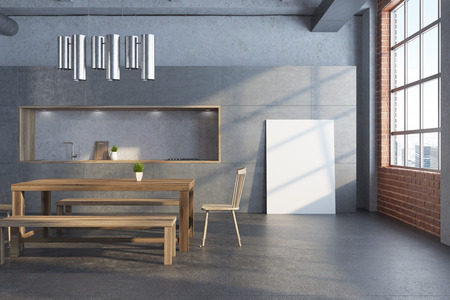 White dining room interior with a long wooden table, two chairs and a gray kitchen in the background. A poster 3d rendering mock up Stock Photo