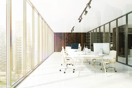 Modern dark wooden office interior with a concrete floor and rows of computer tables. 3d rendering mock up toned image double exposure