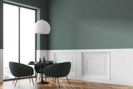 Black round table standing in a cafe corner with green chairs near it and a panoramic window in the background. 3d rendering mock up Stock Photo