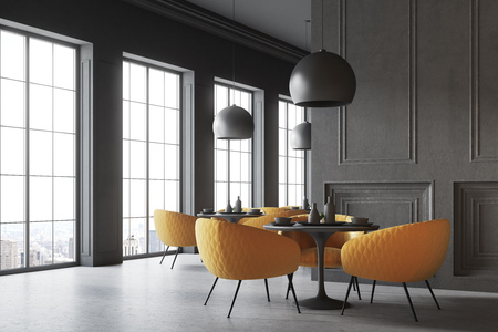 Black restaurant corner with a concrete floor, round black tables and yellow chairs. A blank wall fragment. 3d rendering mock up
