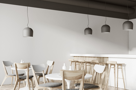 Corner of a white cafe with a wooden floor, round white tables and gray and wooden chairs. A bar with stools. 3d rendering mock up Stock Photo