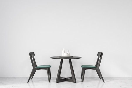 Round table with green and black wooden chairs near it standing in an empty room with white walls and a concrete floor. 3d rendering mock up