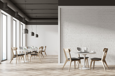 White cafe interior with a wooden floor, round white tables and gray and wooden chairs. A white wall fragment. 3d rendering mock up