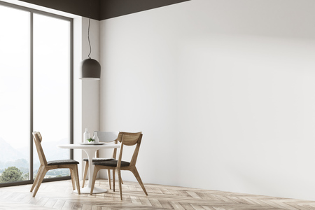 White round table standing in a cafe corner with gray and wooden chairs near it and a panoramic window in the background. 3d rendering mock up