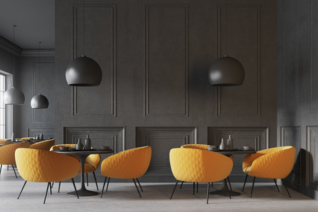 Black cafe interior with a concrete floor, round black tables and yellow chairs. 3d rendering mock up