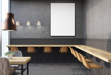 Loft cafe interior with concrete walls and floor, and wooden tables with yellow and gray chairs near them. A framed vertical poster. 3d rendering mock up