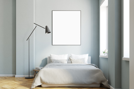 Interior of a modern bedroom with gray walls, a master bed and a wooden floor. A vertical framed poster. 3d rendering mock up