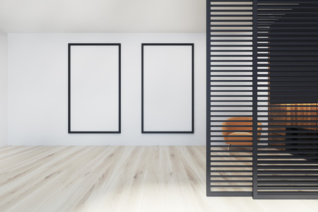 Modern office waiting room interior with white, black and wooden walls, a wooden floor, and a yellow armchair near two framed vertical posters. 3d rendering mock up Stock Photo - 95655358