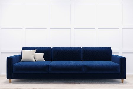 Delicieux Long And Comfortable Dark Blue Sofa Standing In A Room With White Walls And  A Light