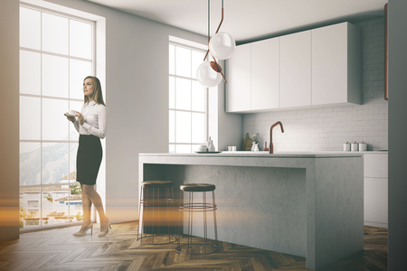 Gray wall kitchen corner with balck and gray countertops, a sink and a blank wall fragment. A businesswoman in 3d rendering mock up toned image Reklamní fotografie