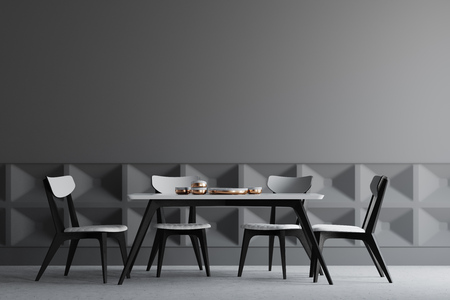 Dark gray dining room interior with a concrete floor, dark gray and patterned walls, and a dark wooden and white table with chairs. 3d rendering mock up
