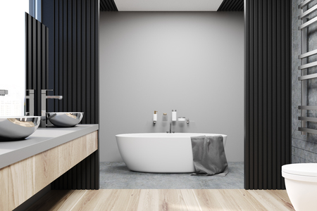 Gray and concrete bathroom interior with a concrete floor, a bathtub, a double sink on a vanity unit and a large mirror. 3d rendering mock up