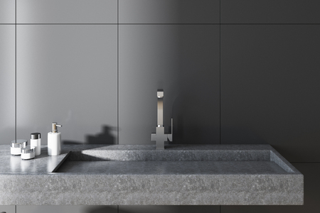Gray wall bathroom interior with a long gray sink and a chair with towels. A close up. 3d rendering.