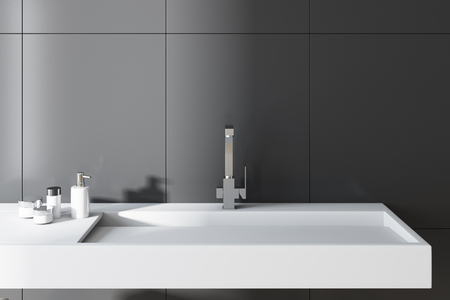 Gray wall bathroom interior with a long white sink and a chair with towels. A close up. 3d rendering. Stock Photo