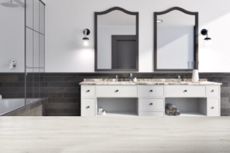 White and brick bathroom interior idea. A tiled floor, a double sink with original mirrors and a bathtub. A front view. 3d rendering mock up blurred Stock Photo