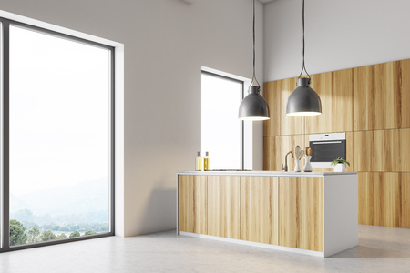 White wall loft kitchen corner with a concrete floor, and wooden countertops under original lamps. 3d rendering mock up