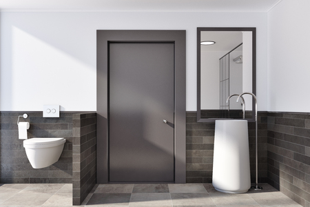 White and brick bathroom interior idea. A tiled floor, a round sink with a vertical mirror and a toilet. A front view. 3d rendering mock up Stock Photo