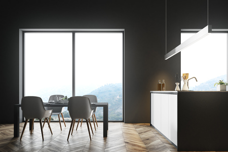 Dark gray wall loft kitchen interior with a wooden floor, and white countertops under an original lamp. A table with white chairs. 3d rendering mock up Banque d'images - 98027102