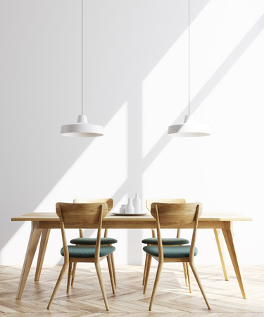 Modern minimalistic dining room interior with white walls, a wooden floor and a long table with chairs near it. 3d rendering mock up Stock Photo