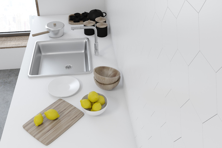 White tiled kitchen interior with a white countertop and a built in sink. A top view. Concept of home made food. 3d rendering mock up Stock Photo