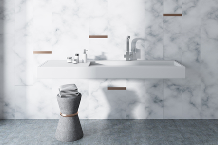 White marble wall bathroom interior with a long white sink and a chair with towels. A front view. 3d rendering