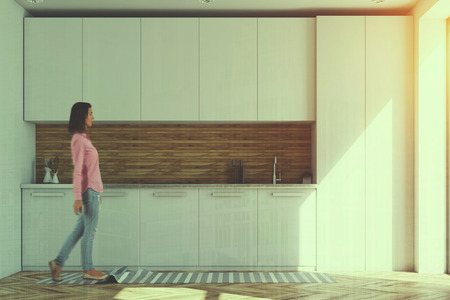 Luxury kitchen interior with white and wooden walls, a wooden floor, white countertops and a large window. A woman. 3d rendering mock up toned image double exposure
