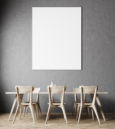 Concrete dining room interior with a wooden floor, a table and chairs and a vertical poster hanging above it. 3d rendering mock up Stock Photo