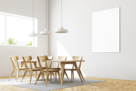 White dining room corner with a wooden floor, a table and chairs and a vertical poster hanging above it. 3d rendering mock up Stock Photo