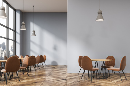Gray loft restaurant interior. with a wooden floor, round tables and beige chairs. 3d rendering, mock up