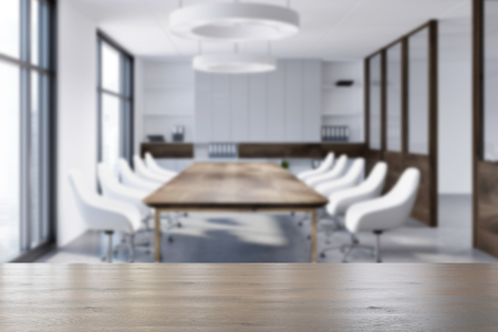 White boardroom interior with a concrete floor, loft windows, a long wooden table and white chairs. 3d rendering mock up blurred