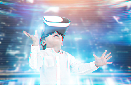 Cute little boy in a white shirt and VR glasses. Concept of the future technology. A futuristic interface background. Toned image double exposure