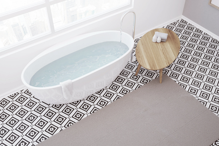 Luxury bathroom interior with a geometric pattern tiled floor, a large window, and a white bathtub with a shower. A top view. 3d rendering mock up Stock Photo