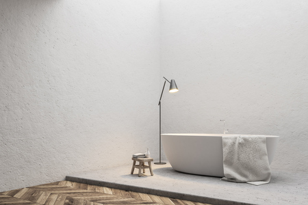 Corner of a white bathtub with a towel hanging on it standing on a concrete floor of a minimalistic bathroom. A small chair. 3d rendering mock up
