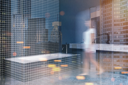 Woman in a black tiled bathroom corner with a long sink and a loft window. A concrete floor. A cozy home concept 3d rendering mock up toned image double exposure Stock Photo