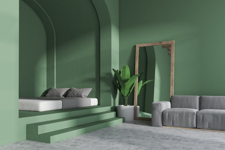 Corner of a cozy bedroom with a gray sofa, a bed on the piedestal and a tall mirror standing near the wall. 3d rendering mock up