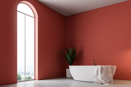 Minimalistic red bathroom interior with a white bathtub, a towel hanging on it, and a potted tree. A window 3d rendering mock up