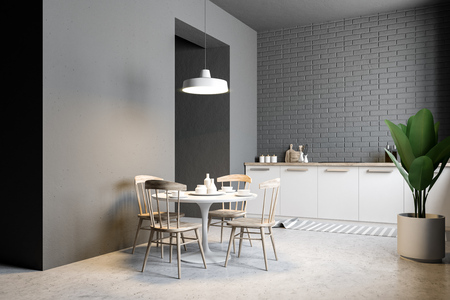 Small gray brick kitchen and dining room corner with a marble floor, a row of countertops and a round table with chairs standing near it. A potted plant. 3d rendering mock up 免版税图像