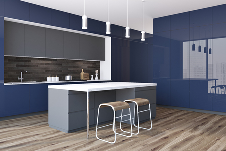 Side View Of A Blue Kitchen Countertops With Built In Appliances In A White  Kitchen Interior