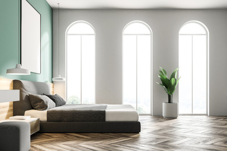 Arched windows green bedroom interior with a wooden floor, a king size bed and a frame vertical poster hanging above it. 3d rendering mock up