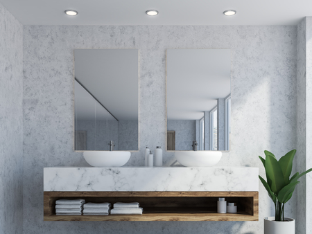 Bathroom interior with marble walls, a double sink standing on white countertops and a two vertical mirrors hanging above it. A close up 3d rendering