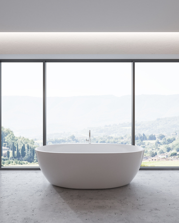 Bathroom interior with a concrete floor, a panoramic window with a mountain view and a white elegant bathtub. 3d rendering Stock Photo