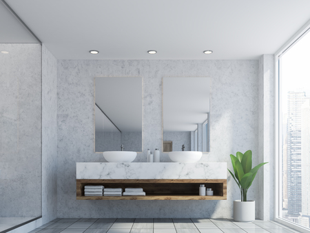 Bathroom interior with marble walls, a double sink standing on white countertops and a two vertical mirrors hanging above it. 3d rendering Banco de Imagens